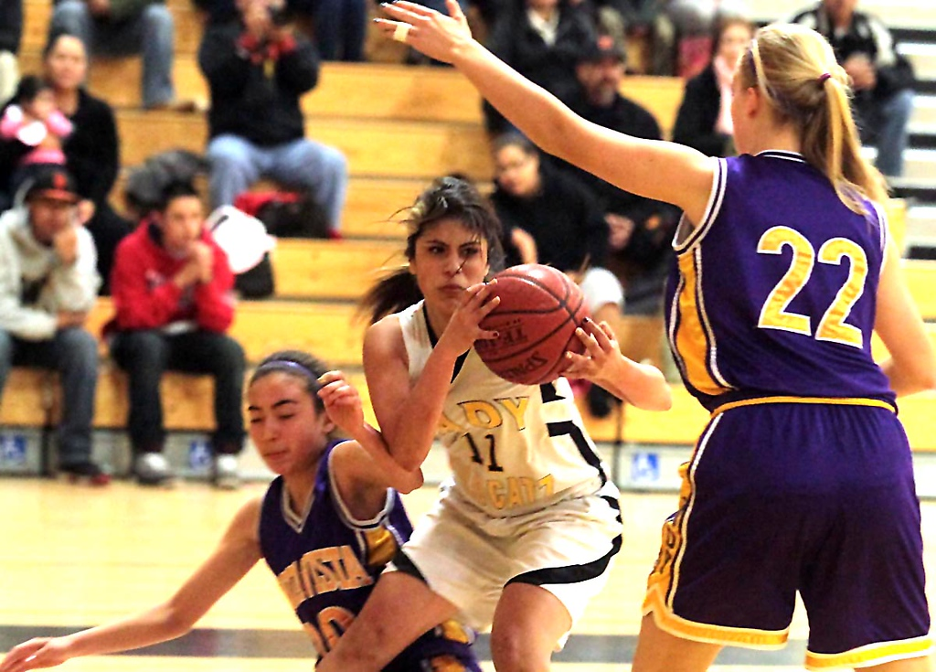 . Watsonville sophomore Melena Cueva grabs a rebound between Monta Vista defenders in their Central Coast Section Division I playoffs game in Watsonville, Calif., on Tuesday, Feb. 19, 2013. Monta Vista won the first-round game 54-49. (Shmuel Thaler/Sentinel)