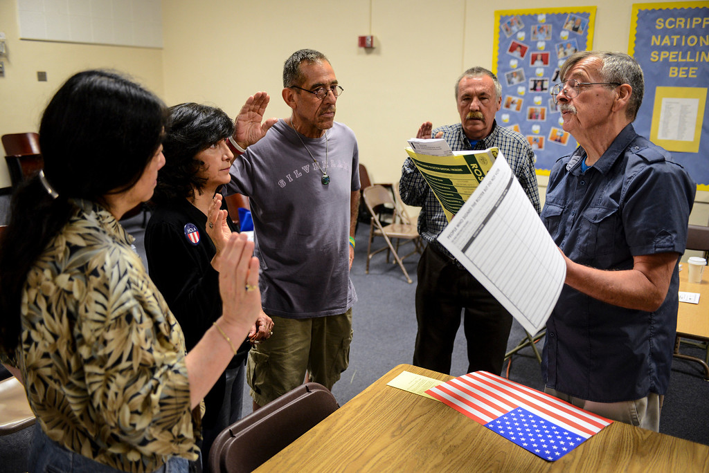 . Polling inspector Matthew Klempa, right, swears in poll workers at Allesandro Elementary school in Los Angeles early Tuesday morning.  Los Angeles residents will vote for a new mayor, Garcetti or Wendy Gruel in the citywide election.  Photo by David Crane/Staff Photographer