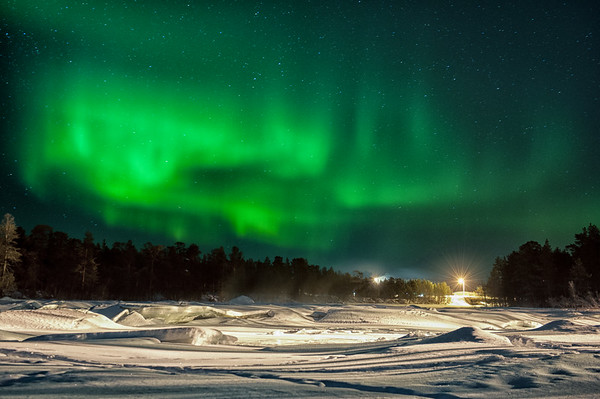 Northern Lights over the River Juutua in Inari.