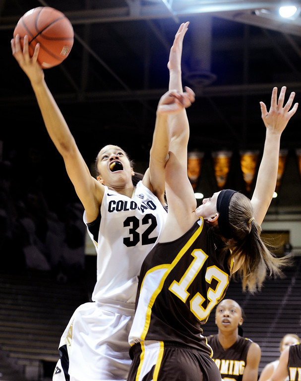 . Colorado\'s Arielle Roberson (32) shoots over Wyoming\'s Ashley Sickles (13) during their NCAA college basketball game, Wednesday, Nov. 28, 2012, in Boulder, Colo. (AP Photo/The Daily Camera, Jeremy Papasso)
