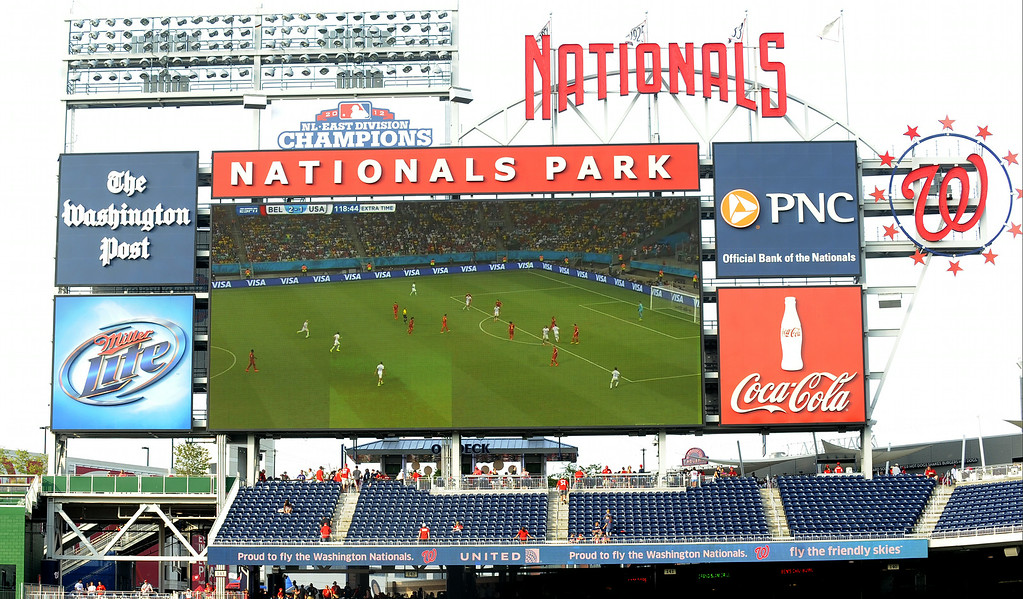 . The Washington Nationals show the US vs Belgium World Cup soccer match on the big screen before a baseball against the Colorado Rockies on July 1, 2014 at Nationals Park in Washington, DC.  (Photo by Mitchell Layton/Getty Images)