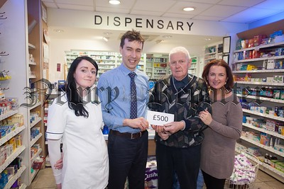 Tony Hadden from Newry was the winners of the McKeevers instore competition in conjunction with the Southern Area Hospice. He is pictured recieving his prize from Paul McKeever. Also pictured is Louise Harvey and Siobhan McArdle. R1606029