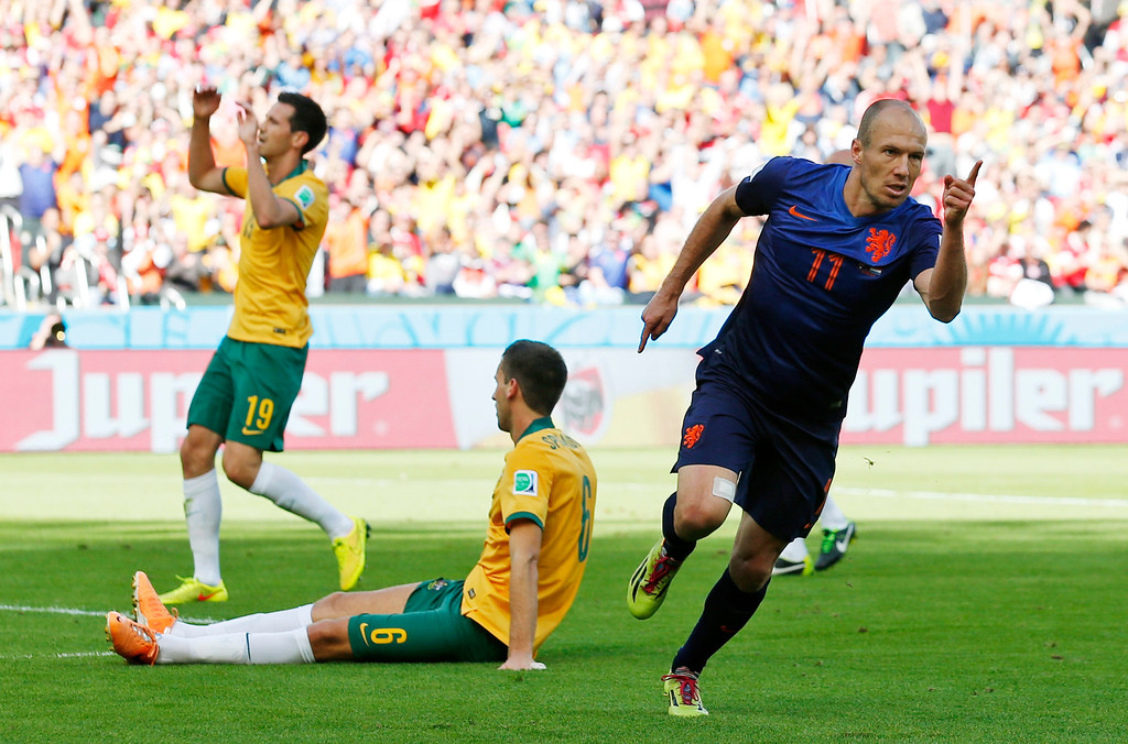 . Netherlands\' Arjen Robben (11) celebrates after scoring his side\'s first goal during the group B World Cup soccer match between Australia and the Netherlands at the Estadio Beira-Rio in Porto Alegre, Brazil, Wednesday, June 18, 2014. (AP Photo/Jon Super)