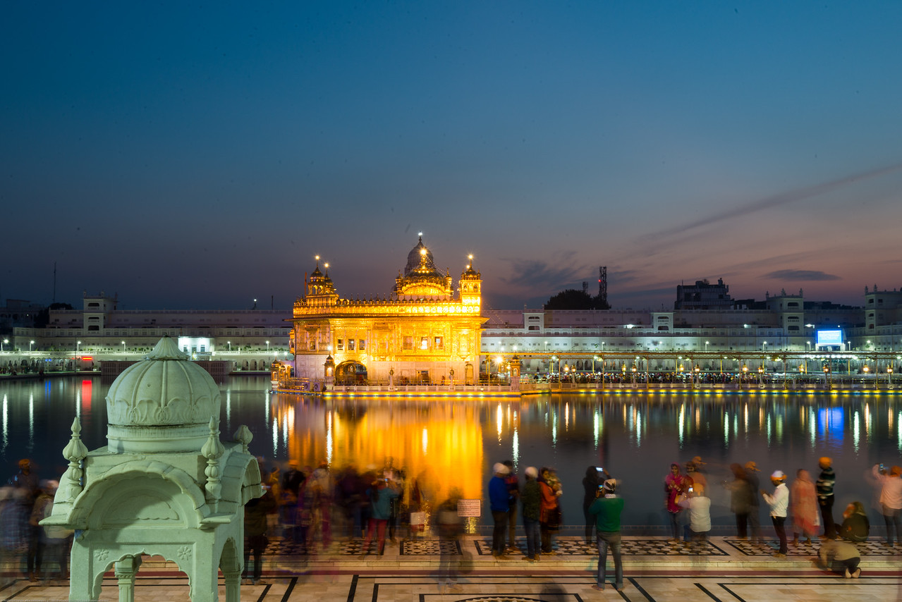 """Golden hour picture at the Golden Temple.<br /> <br /> The Harmandir Sahib (Punjabi: ਹਰਿਮੰਦਰ ਸਾਹਿਬ), also Darbar Sahib (Punjabi: ਦਰਬਾਰ ਸਾਹਿਬ, )(The abode of God), and informally called the """"Golden Temple"""", is the holiest Sikh gurdwara located in the city of Amritsar, Punjab, North India."""