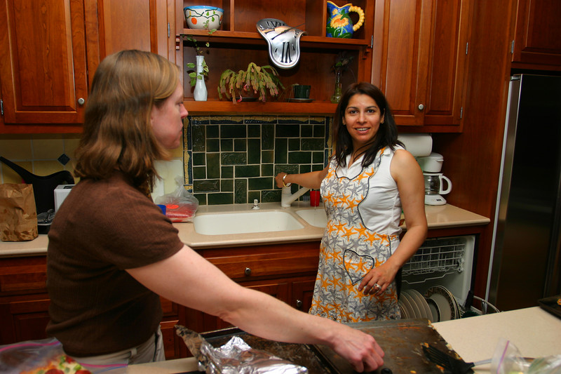 Linda and Saadia cooking in preparation for Timmy's arrival.