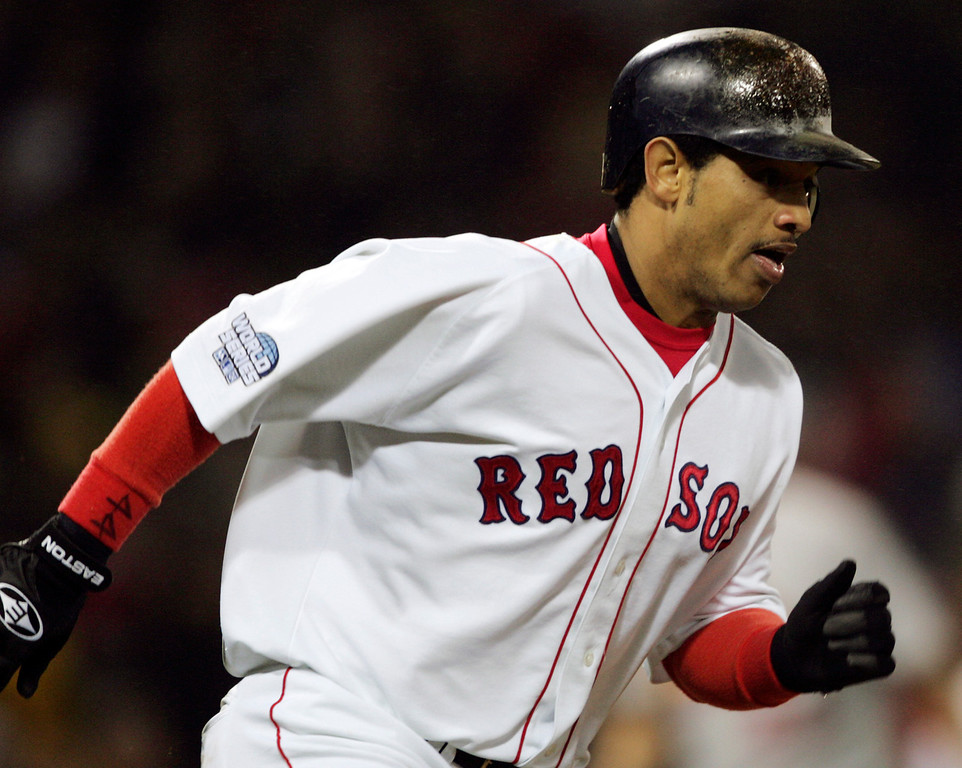 . Boston Red Sox\'s Orlando Cabrera rounds the bases after his two-run single  in the sixth  inning of Game 2 of the World Series Sunday, Oct. 24, 2004 in Boston. (AP Photo/Charles Krupa)