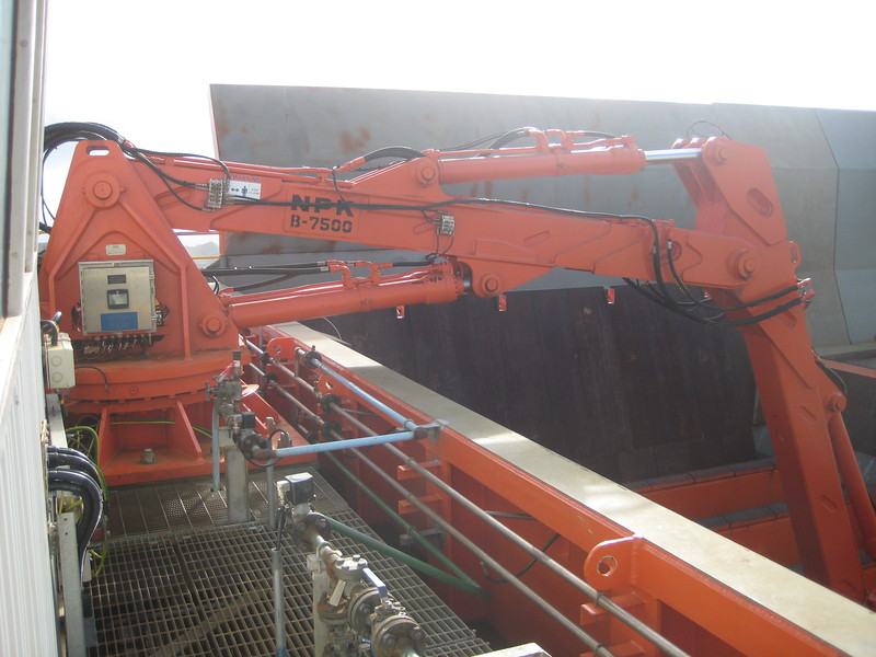 NPK B7500 pedestal boom system with GH9 hydraulic hammer-breaking bridged rock at grizzly crusher in quarry (1).jpg