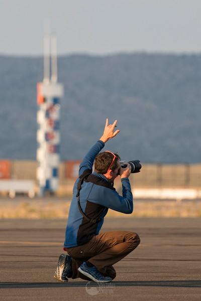 Photographer Throwing Horns