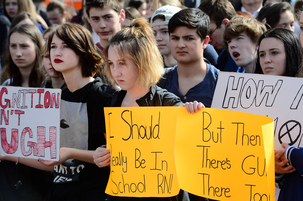 . Harper Staunton, a student at Centennial Middle School,  listens to the speakers at the Boulder County Courthouse during a walkout to protest gun violence on Wednesday morning.  For more photos go to dailycamera.com Paul Aiken Staff Photographer March 14, 2018.