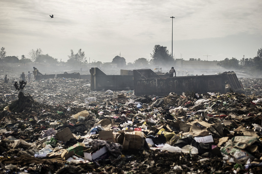 . People sift through garbage at the Maputo municipal garbage dumping site in Maputo on October 14, 2014. GIANLUIGI GUERCIA/AFP/Getty Images