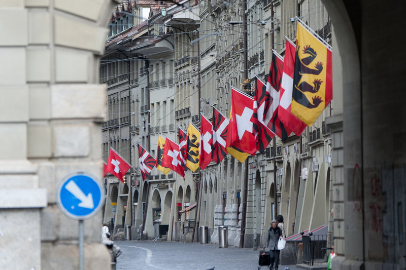 Flags along the shopping promenade in Zytglogge clock tower - Bern, Switzerland
