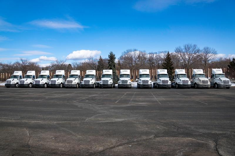 Unfi truck Line up.jpg