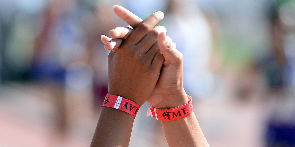 . Ontario teammates high five after winning the 1600 medley seeded during the Mt. SAC Relays in Hilmer Lodge Stadium on the campus of Mt. San Antonio College in Walnut, Calif., on Saturday, April 19, 2014.  (Keith Birmingham Pasadena Star-News)