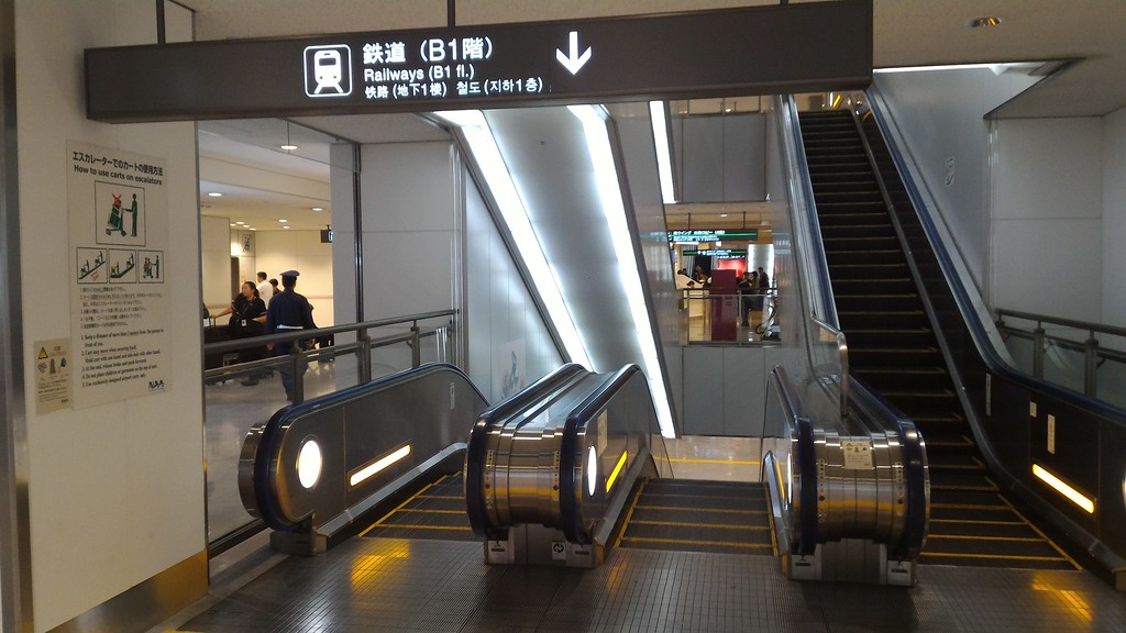 Escalators down to trains in arrivals hall