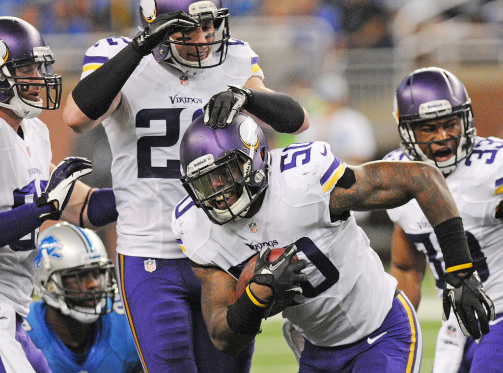 . Vikings outside linebacker Erin Henderson, middle, is congratulated by free safety Harrison Smith, top, after Henderson\'s interception of a pass by Lions quarterback Matthew Stafford in the second quarter.  (Pioneer Press: Chris Polydoroff)