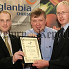 Niall Cunningham from Greencastle, Kilkeel took Second Place in the Glanbia Cheese Milk Quality Awards and was presented with his award by Conor O'Donovan and Cecil Morton of Glanbia Cheese.