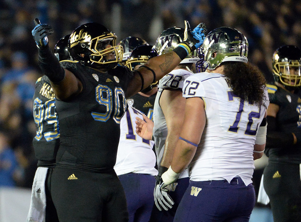 . UCLA Bruins\'s Ellis McCarthy (90) reacts after sacking Washington Huskies quarterback Keith Price ( not pictured) during the first half of their college football game in the Rose Bowl in Pasadena, Calif., on Friday, Nov. 15, 2013.   (Keith Birmingham Pasadena Star-News)