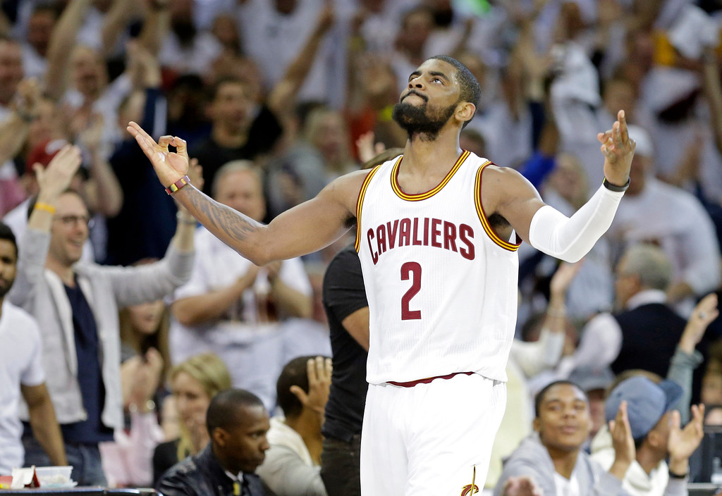 . Cleveland Cavaliers\' Kyrie Irving celebrates after making a 3-point shot at the buzzer to end the second quarter of a first round NBA playoff basketball game against the Cleveland Cavaliers Sunday, April 19, 2015, in Cleveland. (AP Photo/Mark Duncan)