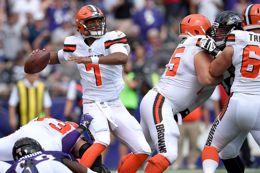. Cleveland Browns quarterback DeShone Kizer (7) passes the ball under pressure during the first half of an NFL football game against the Baltimore Ravens in Baltimore, Sunday, Sept. 17, 2017. (AP Photo/Nick Wass)