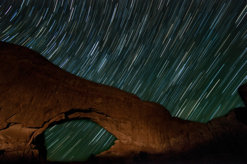 Summer stars tracking behind the Window Arch in Arches National Park