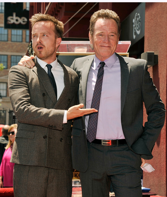 """. Bryan Cranston, right, star of the television series \""""Breaking Bad,\"""" poses with fellow cast member Aaron Paul after receiving a star on the Hollywood Walk of Fame on Tuesday, July 16, 2013 in Los Angeles. (Photo by Chris Pizzello/Invision/AP)"""