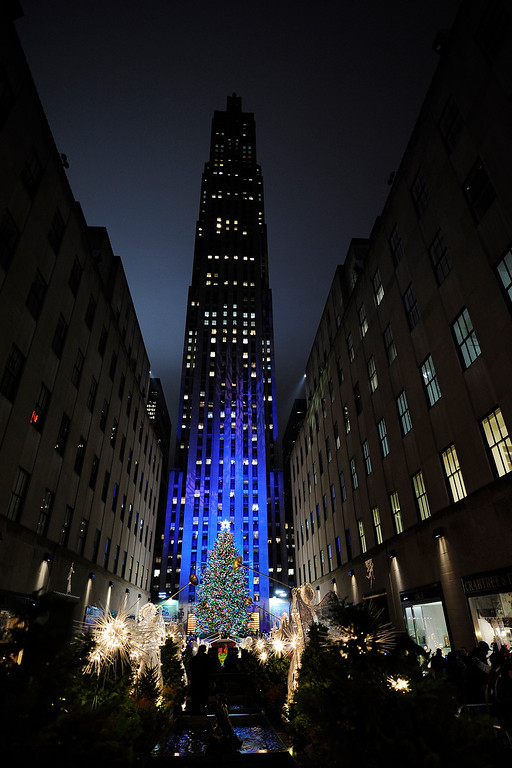 . FILE- This Dec. 2, 2009 file photo shows the Rockefeller Center Christmas tree standing lit during the 77th annual lighting ceremony in New York.(AP Photo/Stephen Chernin,File)