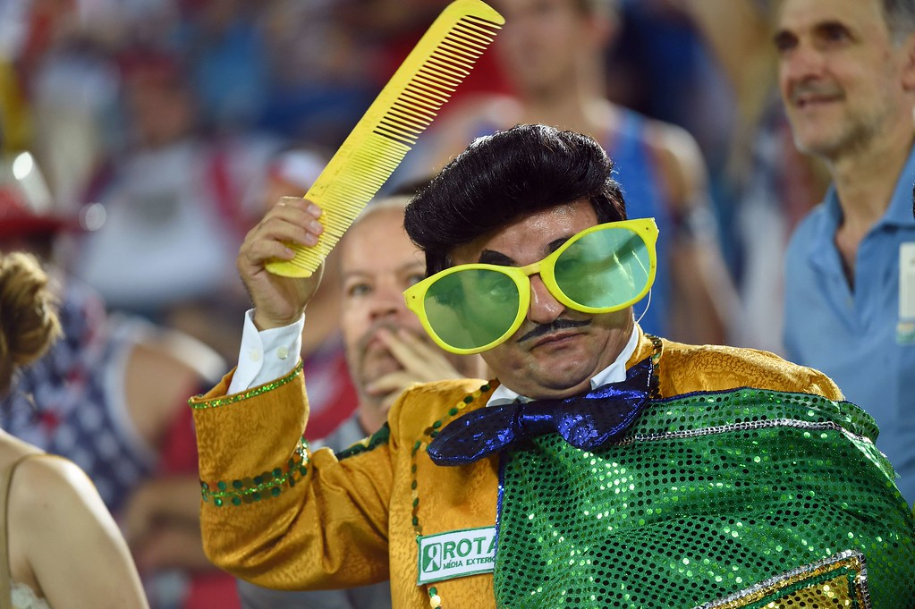 . A fan cheers before a Group G football match between Ghana and US at the Dunas Arena in Natal during the 2014 FIFA World Cup on June 16, 2014.   AFP PHOTO / EMMANUEL  DUNAND/AFP/Getty Images
