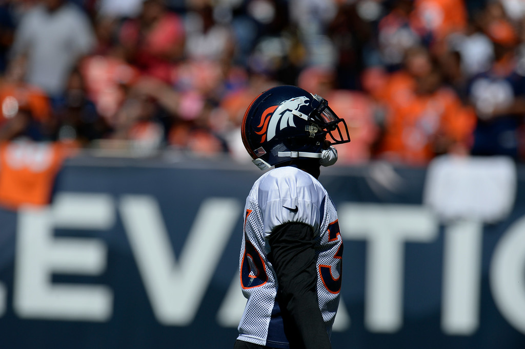 . Denver Broncos CB, Kayvon Webster, pumps up the crowd entering the field for practice and scrimmage at Sports Authority Field at Mile High Saturday afternoon, August 02, 2014. (Photo By Andy Cross / The Denver Post)