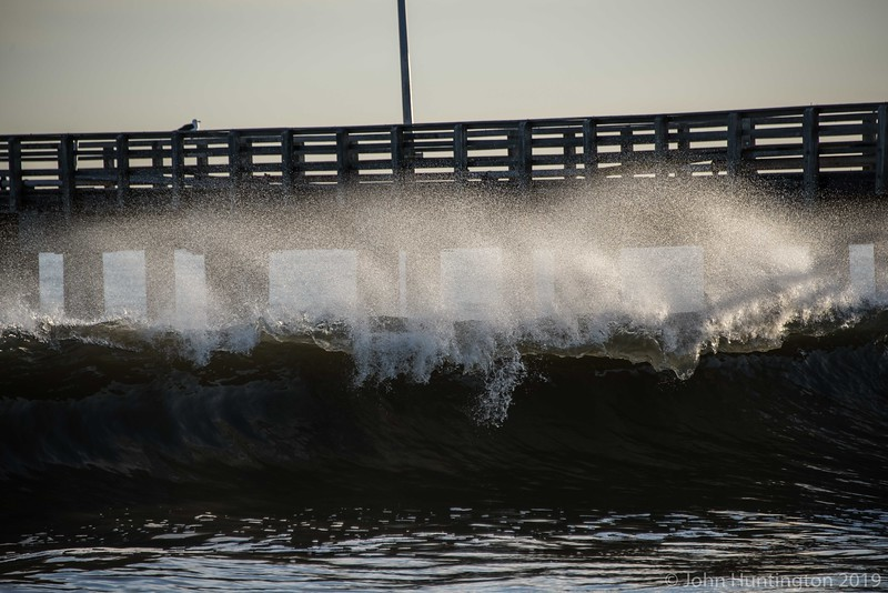 A wave breaking under the Coney Island pier.