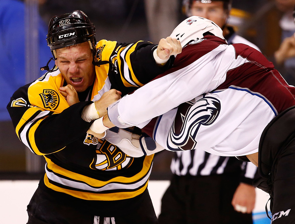 . Shawn Thornton #22 of the Boston Bruins fights Patrick Bordeleau #58 of the Colorado Avalanche in the second period during the game on October 10, 2013 at TD Garden in Boston, Massachusetts. (Photo by Jared Wickerham/Getty Images)