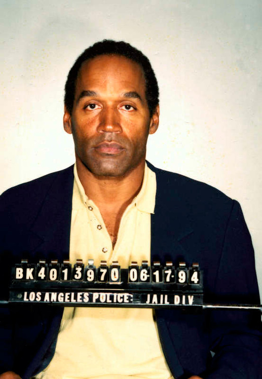 . This is the booking mug for O.J. Simpson, taken Friday, June 17, 1994, after he surrendered to authorities at his Brentwood estate in Los Angeles.  Simpson was charged with two counts of murder in connection with the June 12, 1994 slayings of his ex-wife, Nicole, and acquaintance Ronald Goldman. (AP Photo/Los Angeles Police Department)