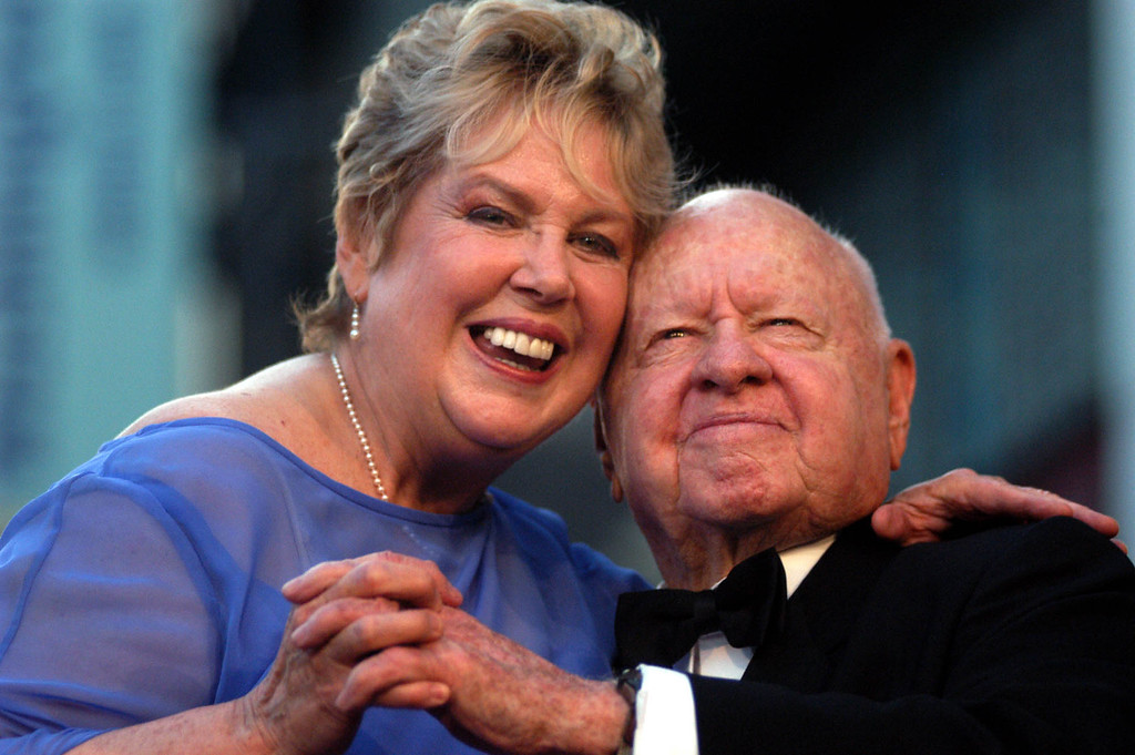 . In this Monday, April 26, 2004, file photo, Jan, left, and Mickey Rooney pose for photographs after having unveiled their star on the Hollywood Walk of Fame in Los Angeles. (AP Photo/Ann Johansson, File)