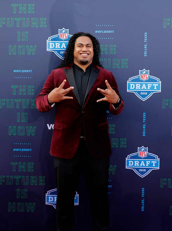 . Washington\'s Vita Vea poses for photos before the first round of the NFL football draft, Thursday, April 26, 2018, in Arlington, Texas. (AP Photo/Eric Gay)
