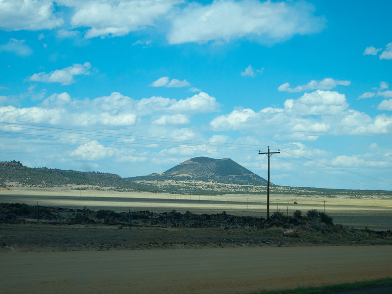 This is the closest picture.  There is a road that goes up to the crater and there is a hiking trail that goes down to the middle of the crater of the cinder cone.  We turned left on that road you see, only to hear horrible banging noises from the driver's side.