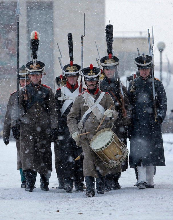 . Historical re-enactors dressed as 1812-era Russian imperial soldiers march during a reenactment of the French Invasion of Russia in 1812, during celebrations to mark the Russian Orthodox Christmas in St. Petersburg, Russia, Monday, Jan. 7, 2013.  Christmas falls on Jan. 7 for Orthodox Christians who rely on the old Julian calendar rather than the  Gregorian calendar adopted by Catholics and Protestants and commonly used in secular life around the world. (AP Photo/Dmitry Lovetsky)