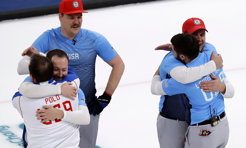. United States team celebrate during the men\'s curling finals match against Sweden at the 2018 Winter Olympics in Gangneung, South Korea, Saturday, Feb. 24, 2018. United States won gold. (AP Photo/Aaron Favila)