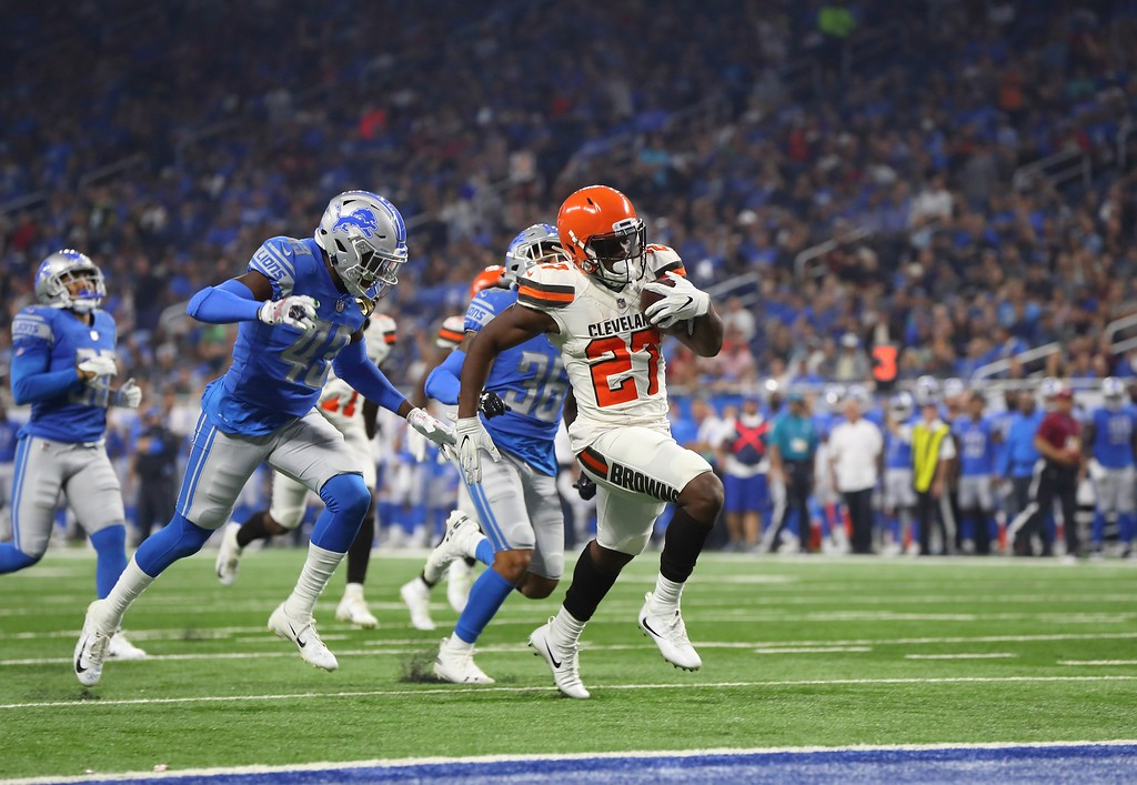 . Cleveland Browns running back Matt Dayes (27) pulls away from the Detroit Lions defense for a 42-yard rushing touchdown during the first half of an NFL football preseason game, Thursday, Aug. 30, 2018, in Detroit. (AP Photo/Paul Sancya)