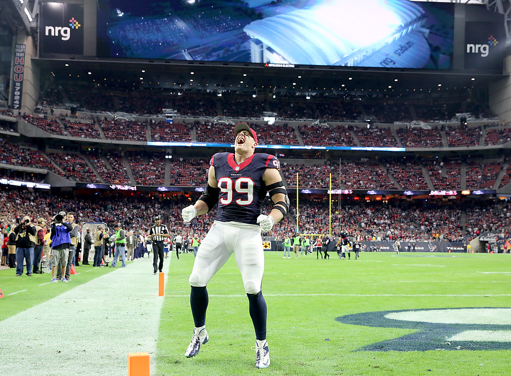. HOUSTON, TX - DECEMBER 28: J.J. Watt #99 of the Houston Texans screams before playing the Jacksonville Jaguars in a NFL game on December 28, 2014 at NRG Stadium in Houston, Texas. (Photo by Thomas B. Shea/Getty Images)