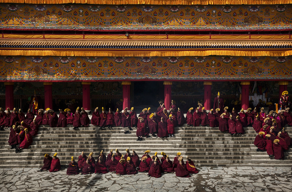 . Tibetan Buddhist monks gather during Monlam or the Great Prayer rituals on March 5, 2015 at the Labrang Monastery, Xiahe County, Amdo, Tibetan Autonomous Prefecture, Gansu Province, China. Labrang Monastery is one of the six great monasteries of the Gelug school of Tibetan Buddhism and one of the largest outside of the Tibetan Autonomous Region. Monlam, the most important prayer event for many Tibetans was banned during the Cultural Revolution in China but once again in recent years it is celebrated in many areas. (Photo by Kevin Frayer/Getty Images)