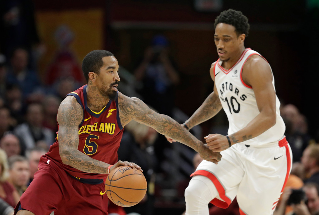 . Cleveland Cavaliers\' JR Smith (5) drives past Toronto Raptors\' DeMar DeRozan (10) in the first half of an NBA basketball game, Wednesday, March 21, 2018, in Cleveland. (AP Photo/Tony Dejak)