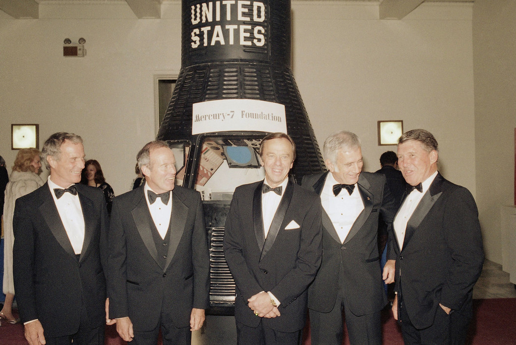 . Astronaut Alan Shepard, center is surrounded by fellow Mercury Astronauts as they pose for photographers in front of a mock up of the Mercury Capsule at the California Science & Industry Museum in Los Angeles on Monday, May 5, 1961 before a formal dinner to honor Shepard?s flight aboard Freedom 7. Pictures left to right are: Scott Carpenter, Gordon Cooper, Alan Shepard, Donald ?Deke? Slaton, and Wally Schirra. (AP Photo/Michael Tweed)