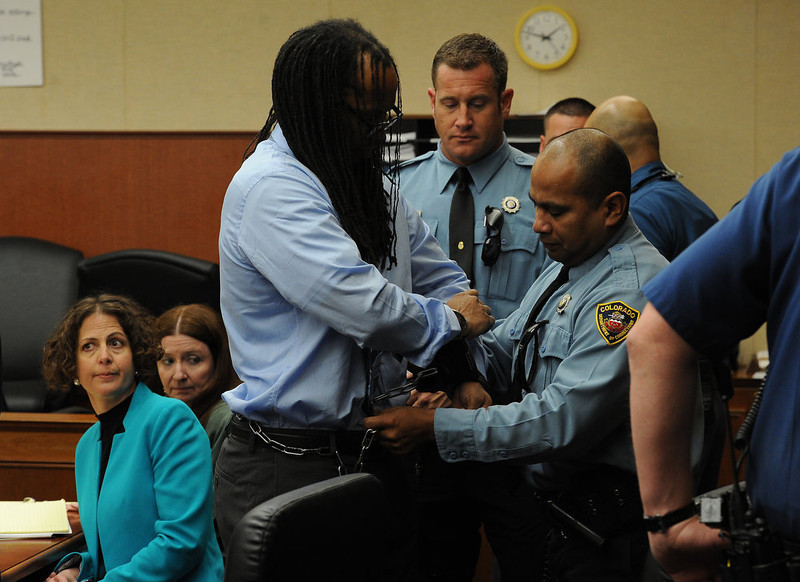 . Deputies take the handcuffs off of Nathan Dunlap as he arrives in court.  A hearing was held today to set a date for the execution of convicted murderer Nathan Dunlap at the Arapahoe County Court in Division court room 408  in Centennial, CO on May 1, 2013.   Judge William Sylvester is the presiding judge on the case.  (Photo by Helen H. Richardson/The Denver Post)
