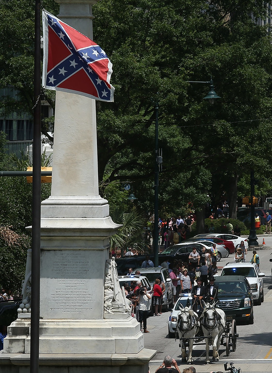 . A horse drawn caisson carrying the casket of Rev. Clementa Pinckney arrives at the South Carolina State House June 24, 2015 in Columbia, South Carolina. Pinckney was one of nine people killed during a Bible study inside Emanuel AME church in Charleston. U.S. President Barack Obama and Vice President Joe Biden are expected to attend the funeral which is set for Friday June 26 at the TD Arena.  (Photo by Joe Raedle/Getty Images)