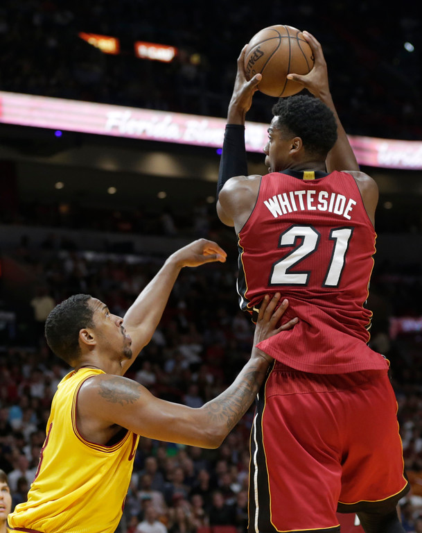 . Miami Heat\'s Hassan Whiteside (21) goes to the basket as Cleveland Cavaliers\' Channing Frye defends during the second half of an NBA basketball game, Saturday, March 4, 2017, in Miami. The Heat defeated the Cavaliers 120-92. (AP Photo/Lynne Sladky)