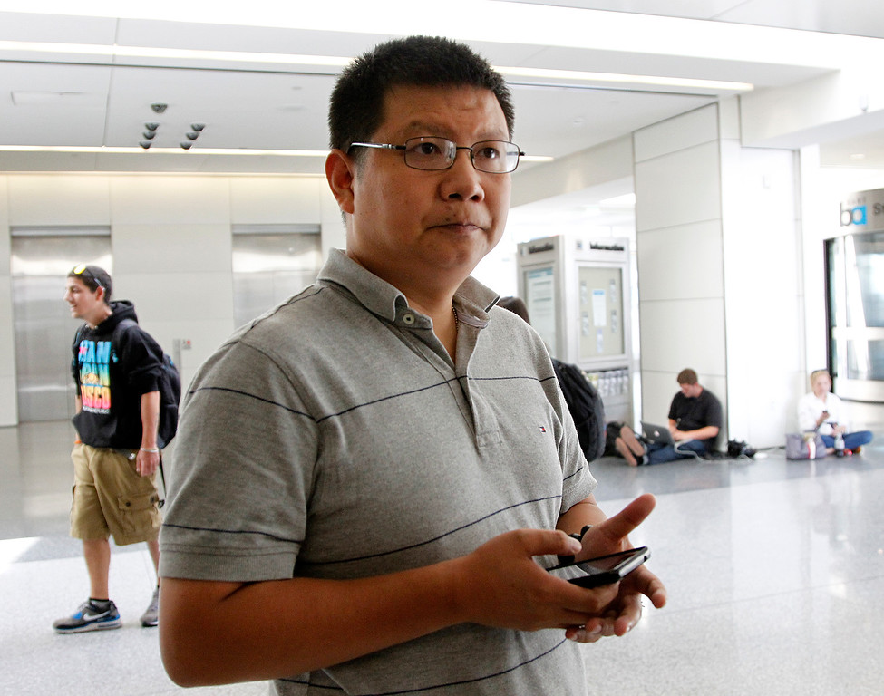 . Ge Gan, of Sunnyvale, waits to visit his friend, who was on the Asiana Airlines Boeing 777 arriving from Seoul, South Korea, that crashed at the San Francisco International Airport, in San Francisco, Calif. on Saturday July 6, 2013.   (LiPo Ching /Bay Area News Group)