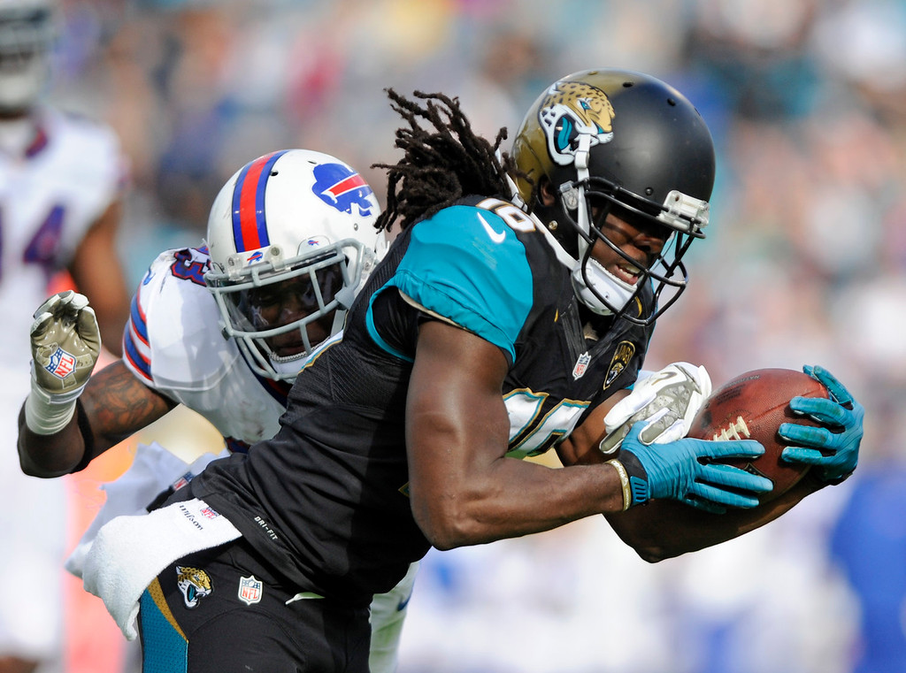 . Jacksonville Jaguars running back Denard Robinson fumbles the ball just before crossing the goal line as he is hit by Buffalo Bills free safety Aaron Williams (23) during the second half of an NFL football game in Jacksonville, Fla., Sunday, Dec. 15, 2013.(AP Photo/Stephen Morton)