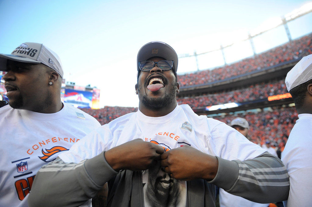 . Von Miller puts on an AFC Championship shirt after the game. The Denver Broncos take on the New England Patriots in the AFC Championship game at Sports Authority Field at Mile High in Denver on January 19, 2014. (Photo by AAron Ontiveroz/The Denver Post)