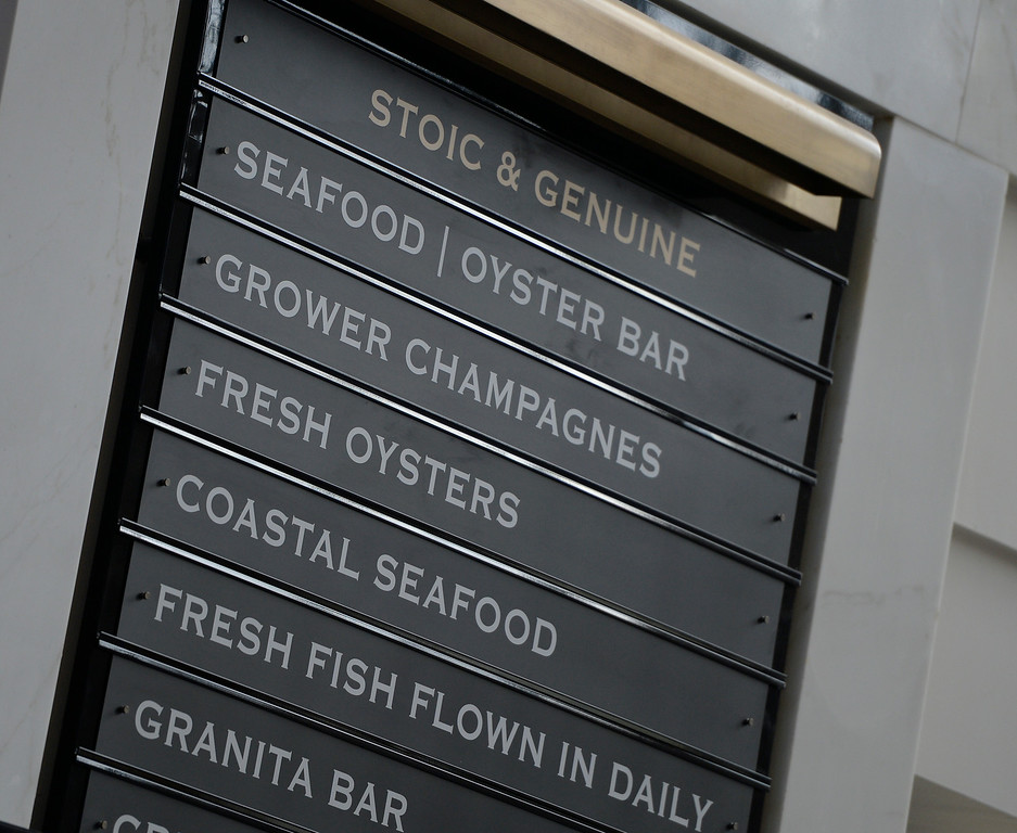 . DENVER, CO - JULY 10:   Denver\'s  renovated Union Station will soon reopen. They showed off some of the refurbish Great Hall on Thursday, July 10, 2014.   The signage for food from Stoic & Genuine. (Denver Post Photo by Cyrus McCrimmon)