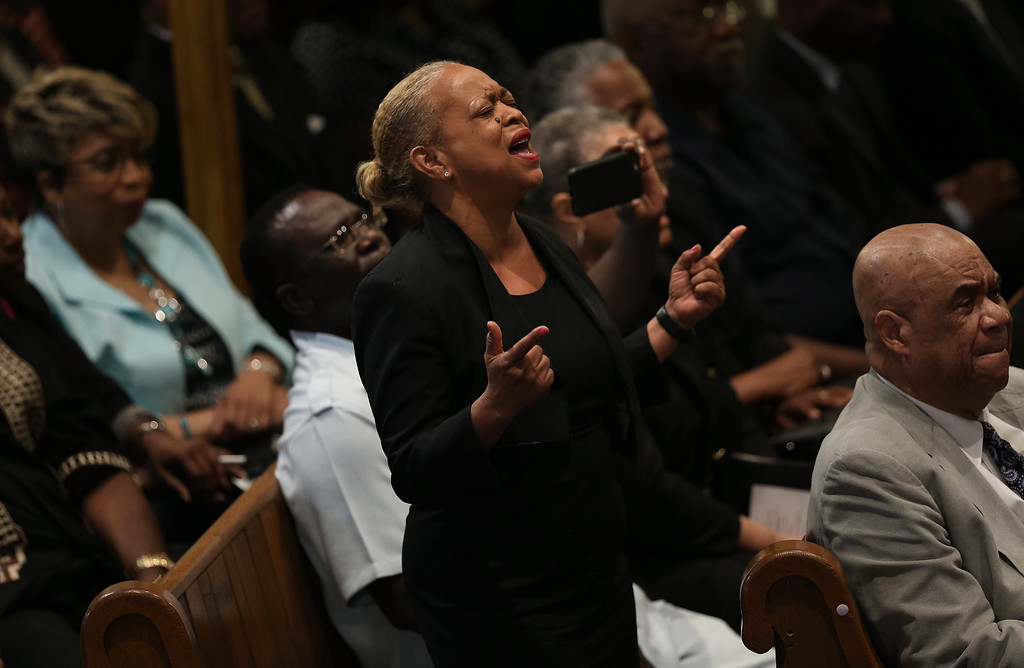 . Congregants pray during a prayer vigil for the nine victims killed at the Emanuel African Methodist Episcopal Church in Charleston, South Carolina at the the Metropolitan AME Church June 19, 2015 in Washington, DC. Earlier today the suspect in the case, Dylan Storm Roof, was charged with nine counts of murder.  (Photo by Win McNamee/Getty Images)