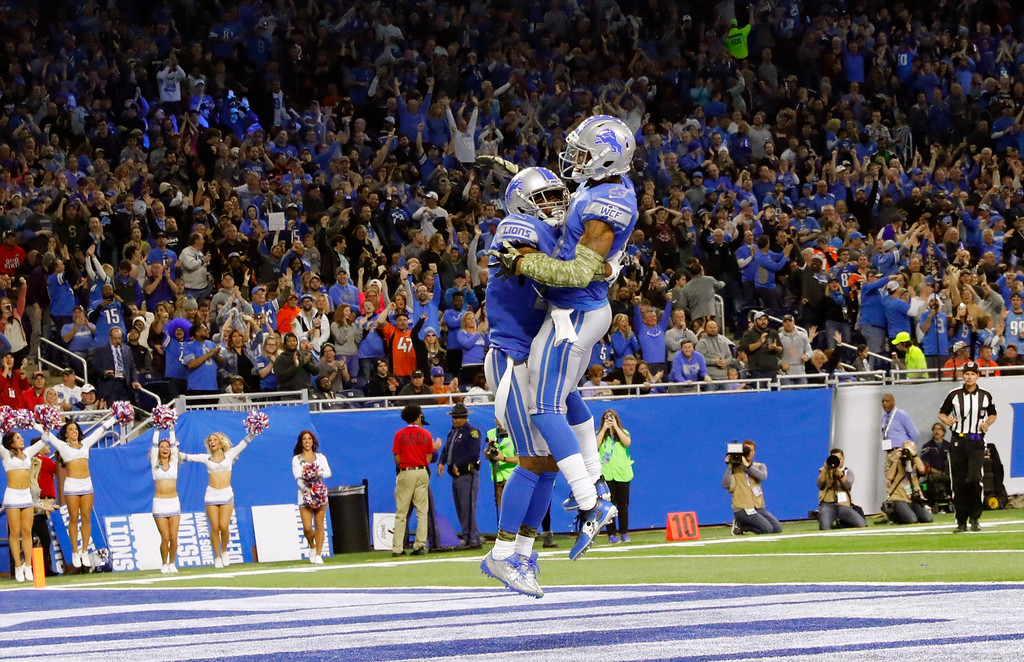 . Detroit Lions cornerbacks Nevin Lawson, left, and Darius Slay leap after Lawson\'s 44-yard fumble recovery for a touchdown during the first half of an NFL football game against the Cleveland Browns, Sunday, Nov. 12, 2017, in Detroit. (AP Photo/Rick Osentoski)